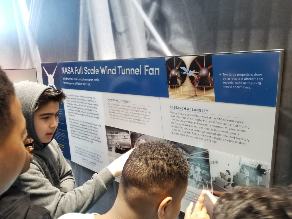 Boys learning about wind tunnels